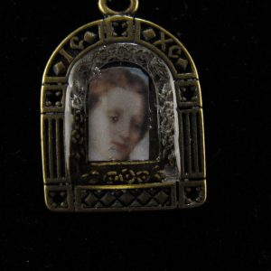 Resined Madonna in Brass 'doorway' Bezel
